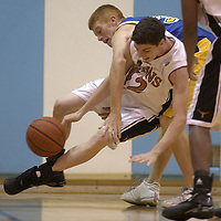 Doby's #42 Scot Gibson tries to keep control of the ball as Klein's #33 Brendan McGehee during the 2003 Texas Invitational basketball tournament at San Jacinto College in Pasadena, 11/20/03. (Photo by Kim Christensen)..