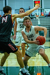 BLOOMINGTON, IL - November 12: Grant Wolfe defended by Christian Wagner during a college basketball game between the IWU Titans  and the Blackburn Beavers on November 12 2019 at Shirk Center in Bloomington, IL. (Photo by Alan Look)