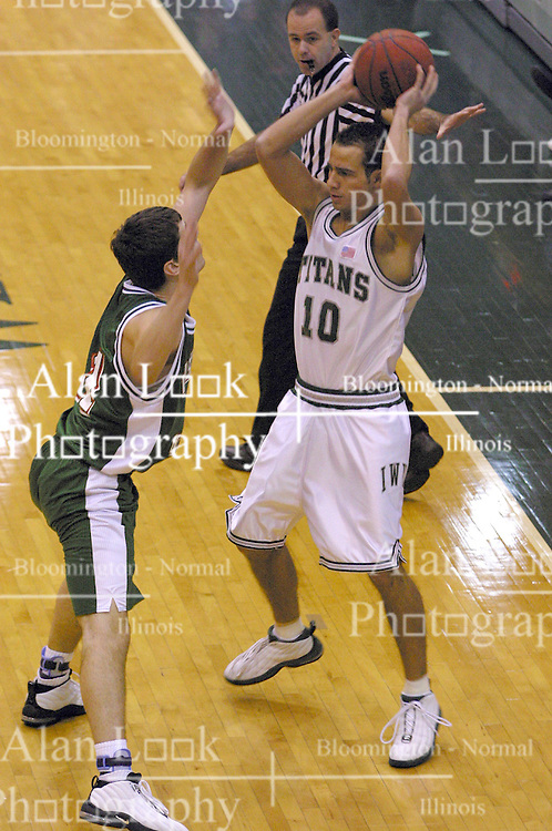 08 December 2002:  Eric Starkey during an NCAA Division 3 basketball game between the Washington University Bears and the Illinois Wesleyan Titans at Shirk Center in Bloomington Illinois.