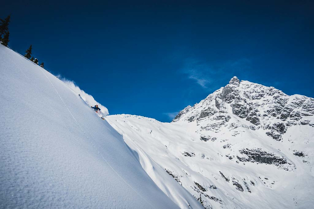 Dropping! Joe Morabito skiing below Loft Peak Glacier, howson Range, British Columbia.