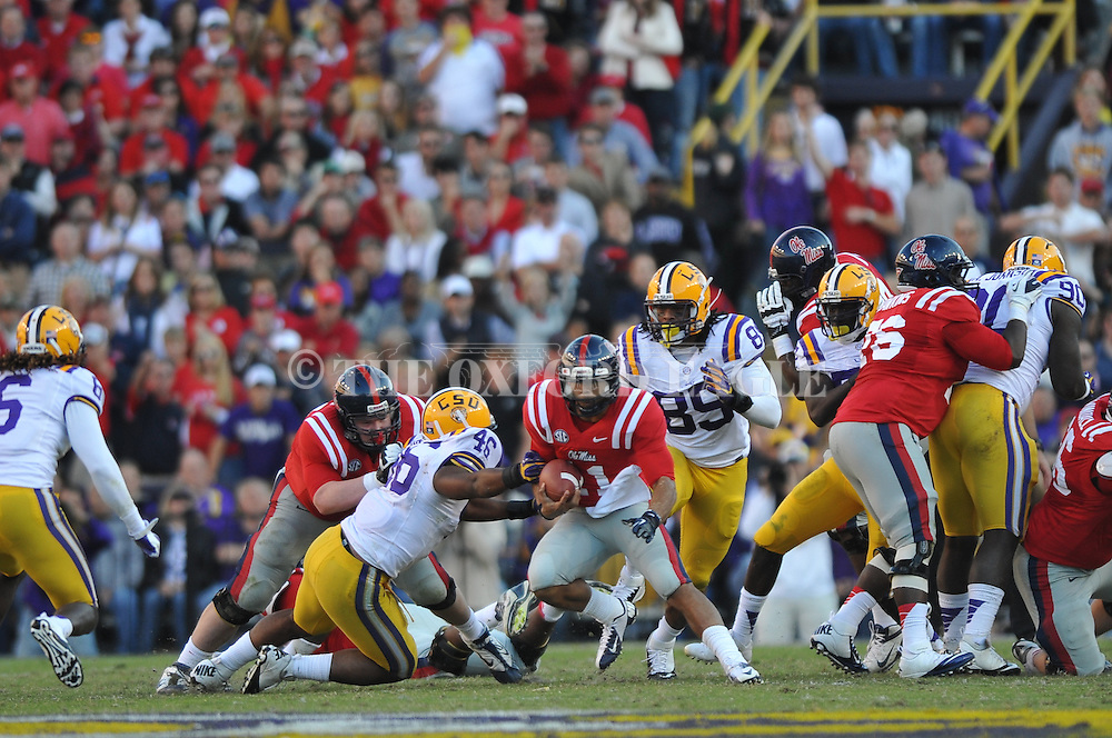 Ole Miss quarterback Barry Brunetti (11) vs. LSU linebacker Kevin Minter (46) at Tiger Stadium in Baton Rouge, La. on Saturday, November 17, 2012.....