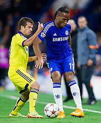 Damjan Bohar of Maribor vs Didier Drogba of Chelsea during football match between Chelsea FC and NK Maribor, SLO in Group G of Group Stage of UEFA Champions League 2014/15, on October 21, 2014 in Stamford Bridge Stadium, London, Great Britain. Photo by Vid Ponikvar / Sportida.com