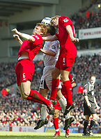 Photo: Aidan Ellis.<br /> Liverpool v Bolton Wanderers. The Barclays Premiership. 09/04/2006.<br /> Liverpool's John Arne Riise and Sami Hyppia combine to stop Bolton's Kevin Davis