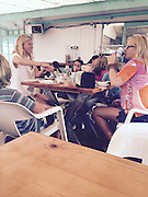 EXCLUSIVE<br /> Actress Gwyneth Paltrow pictured at La Super-Rica taqueria Mexican joint. Gwyneth Paltrow consciously coupling with her lunch at the next table over with a female friend and 3 kids.<br /> ©Exclusivepix Media