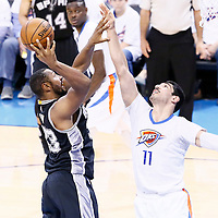 06 May 2016: San Antonio Spurs center Boris Diaw (33) takes a jump shot over Oklahoma City Thunder center Enes Kanter (11) during the San Antonio Spurs 100-96 victory over the Oklahoma City Thunder, during Game Three of the Western Conference Semifinals of the NBA Playoffs at the Chesapeake Energy Arena, Oklahoma City, Oklahoma, USA.