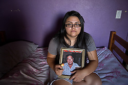 Zayda Hernandez, 14, holds her inhaler inside her room next to a portrait of her grandfather who passed away in March, 2012. All of her family suffers from Asthma and though they can't prove it, believe its because of the coal plant next door. Her grandfather died in march because of cancer. The Sierra Club is working with the Moapa Band of Paiutes to transition NV Energy away from the Reid Gardner coal-fired power plant -- which sits only 45 miles from Las Vegas and a short walk from community housing at the Moapa River Indian Reservation. The Reid Gardner coal plant is literally spewing out tons of airborne pollutants such as mercury, nitrous oxide, sulfur dioxide, and greenhouse gases. This has resulted in substantial health impacts on the Moapa community, with a majority of tribal members reporting a sinus or respiratory ailment. Ayona Hernandez, 13, holds her inhaler inside her room next to a portrait of her grandfather who passed away in March, 2012. All of her family suffers from Asthma and though they can't prove it, believe its because of the coal plant next door. Her grandfather died in march because of cancer. The Sierra Club is working with the Moapa Band of Paiutes to transition NV Energy away from the Reid Gardner coal-fired power plant -- which sits only 45 miles from Las Vegas and a short walk from community housing at the Moapa River Indian Reservation. The Reid Gardner coal plant is literally spewing out tons of airborne pollutants such as mercury, nitrous oxide, sulfur dioxide, and greenhouse gases. This has resulted in substantial health impacts on the Moapa community, with a majority of tribal members reporting a sinus or respiratory ailment.