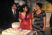 (MODEL RELEASED IMAGE). After sunset, Sandra Raymond Mundi's niece Iris celebrates her Quinceañera, the traditional coming-of-age party for girls. Here flanked by her mother and father (recently divorced) she is about to cut her cake in front of a hundred friends and relatives. (Supporting image from the project Hungry Planet: What the World Eats.)