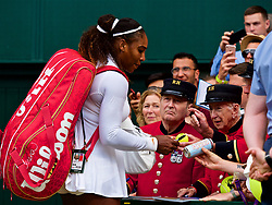LONDON, ENGLAND - Wednesday, July 4, 2018: Serena Williams (USA) signs autographs for Chelsea Pensioners on day three of the Wimbledon Lawn Tennis Championships at the All England Lawn Tennis and Croquet Club. (Pic by Kirsten Holst/Propaganda)
