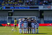 Queens Park Rangers players huddle before kick-off in the EFL Sky Bet Championship match between Queens Park Rangers and Blackburn Rovers at the Loftus Road Stadium, London, England on 19 April 2019.