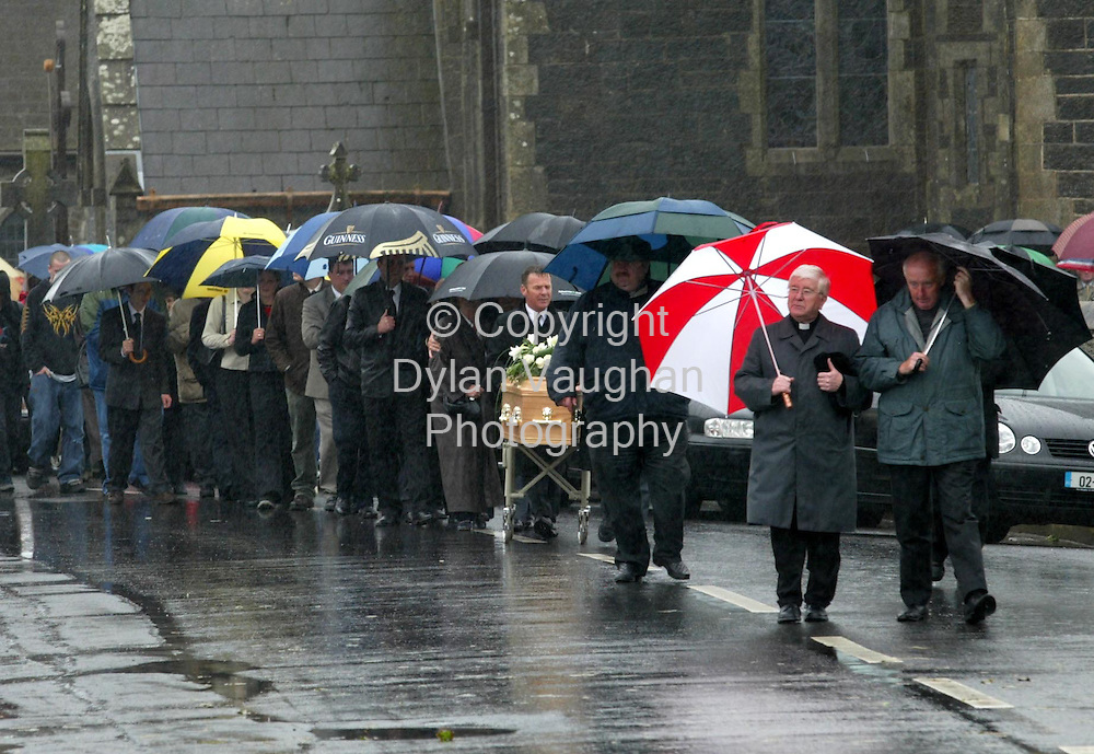 8/8/2002.John Flavins coffin pictured on its way from the Holy Cross to the graveyard at Tramore yesterday.John was Killed in an accident in Tramore at the wekend..Picture Dylan Vaughan