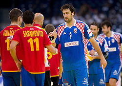 Daniel Sarmiento of Spain and Igor Vori of Croatia after the handball match between Croatia and Spain for 3rd place game at 10th EHF European Handball Championship Serbia 2012, on January 29, 2012 in Beogradska Arena, Belgrade, Serbia.  Croatia defeated Spain 31-27 and won 3rd place. (Photo By Vid Ponikvar / Sportida.com)
