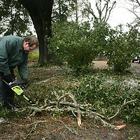 Fleet Spell removes debris on WInston Blvd. in Wilmington, N.C. Thursday February 13, 2014. The area saw two days of freezing rain that caused a loss of power for much of New Hanover, Pender, and Brunswick counties.   (Jason A. Frizzelle)
