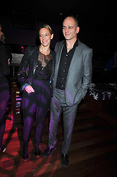 Artist DINOS CHAPMAN and his wife TIPHAINE at the launch of the new Chinawhite at 4 Winsley Street, London on 21st October 2009.
