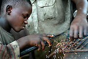 Benin, Cotonou September 2003 - Children learning how to weld.  Cotonou September 2003 - Some types of work make useful, positive contributions to a child's development. Work can help children learn about responsibility and develop particular skills that will benefit them and the rest of society. Often, work is a vital source of income that helps to sustain children and their families. However, across the world, millions of children do extremely hazardous work in harmful conditions, putting their health, education, personal and social development, and even their lives at risk