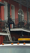 """EXCLUSIVE<br /> Tom Cruise, hanging from a wire, practising a stunt while filimng """"Jack Reacher"""" from a balcony at Chateau Hotel, New Orleans.<br /> ©Exclusivepix Media"""