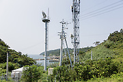 Aoshima, Ehime prefecture, September 4 2015 - Mobile phone operator Docomo recently installed two relay masts on the island.<br /> Aoshima (Ao island) is one of the several « cat islands » in Japan. Due to the decreasing of its poluation, the island now host about 6 times more cats than residents.