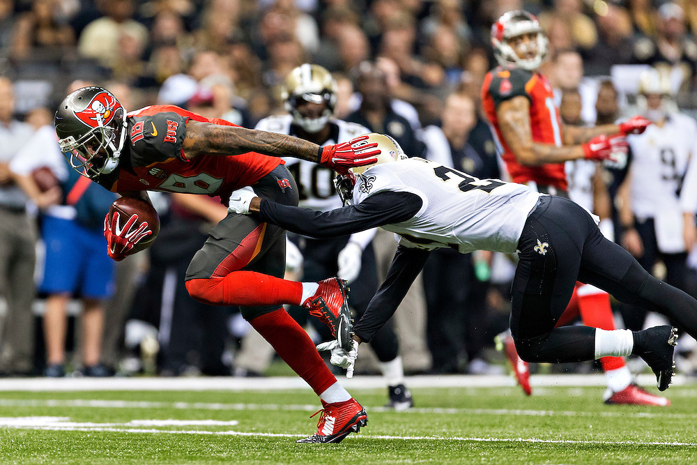 NEW ORLEANS, LA - SEPTEMBER 20:  Louis Murphy #18 of the Tampa Bay Buccaneers tries to avoid the tackle of Damian Swann #27 of the New Orleans Saints at Mercedes-Benz Superdome on September 20, 2015 in New Orleans Louisiana.  The Buccaneers defeated the Saints 26-19.  (Photo by Wesley Hitt/Getty Images) *** Local Caption *** Louis Murphy; Damian Swann