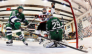 January 27, 2012 - Mercyhurst's Daniel O'Donoghue, left, tries to grab the puck after RIT's Taylor McReynolds, center, slid it past Mercyhurst goaltender Max Strang at Ritter Arena in Henrietta, NY. RIT (15-8-2, 12-4-2 AHA) moved into first place in the Atlantic Hockey Association standings by extending its winning streak to five games after a 5-1 win over Mercyhurst (14-10-3, 11-4-3 AHA).