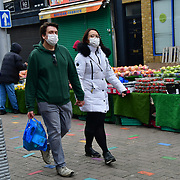 During the coronavirus in UK lockdown seen a couple wearing, at Walthamstow Market,on 28 March 2020 London.