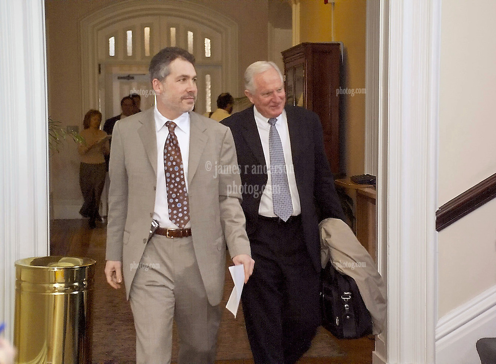 Craig R. Barrett, Chairman of the Board Intel Corporation on right, carrying briefcase and coat, entering the room with Joel M. Podolny on left. Barrett is on his way to speak at the Yale University School of Management Leaders Forum on February 22, 2006