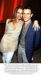 MRS JOHN HITCHCOX and MR ANDREW TUCK, at a reception in London on 16th May 2002.PAA 49