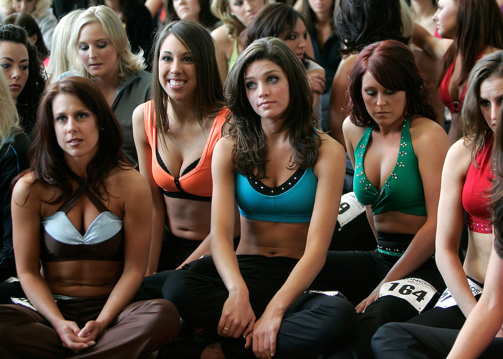 Prospective Denver Broncos cheerleaders listen to the results of who will go to the finals  on the first day of auditions in Denver, Colorado March 25, 2007.  Over 250 women applied for the 34 slots. REUTERS/Rick Wilking (UNITED STATES)