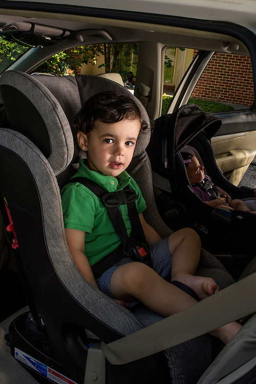 Pikesville, Maryland - June 25, 2015:  Car Seat Lady Alisa Baer's nephew demonstrates the preferred way to seat children in a car, back-facing. <br /> Eitan Aghion, 2, sits in a Clek Foonf convertible car seat ($400-$550) outside their house in Pikesville, Maryland. <br /> <br /> Alisa Baer, 35, and Emily Levine, 34, both from Manhattan and Alisa's mother Deborah Baer, 67, from Pikesville, Maryland operate The Car Seat Lady blog and car seat installation classes available in New York and Maryland. <br /> <br /> CREDIT: Matt Roth for The New York Times<br /> Assignment ID: 30176354A