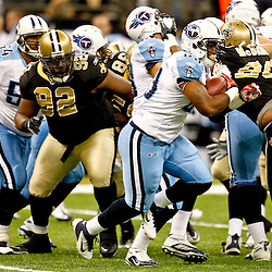 September 1, 2011; New Orleans, LA, USA; Tennessee Titans running back Jamie Harper (23) runs past New Orleans Saints defensive tackle Shaun Rogers (92) during the first quarter of a preseason game at the Louisiana Superdome. Mandatory Credit: Derick E. Hingle