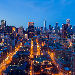 Aerial drone camera view of Chicago loop and skyline from above Roosevelt Park.