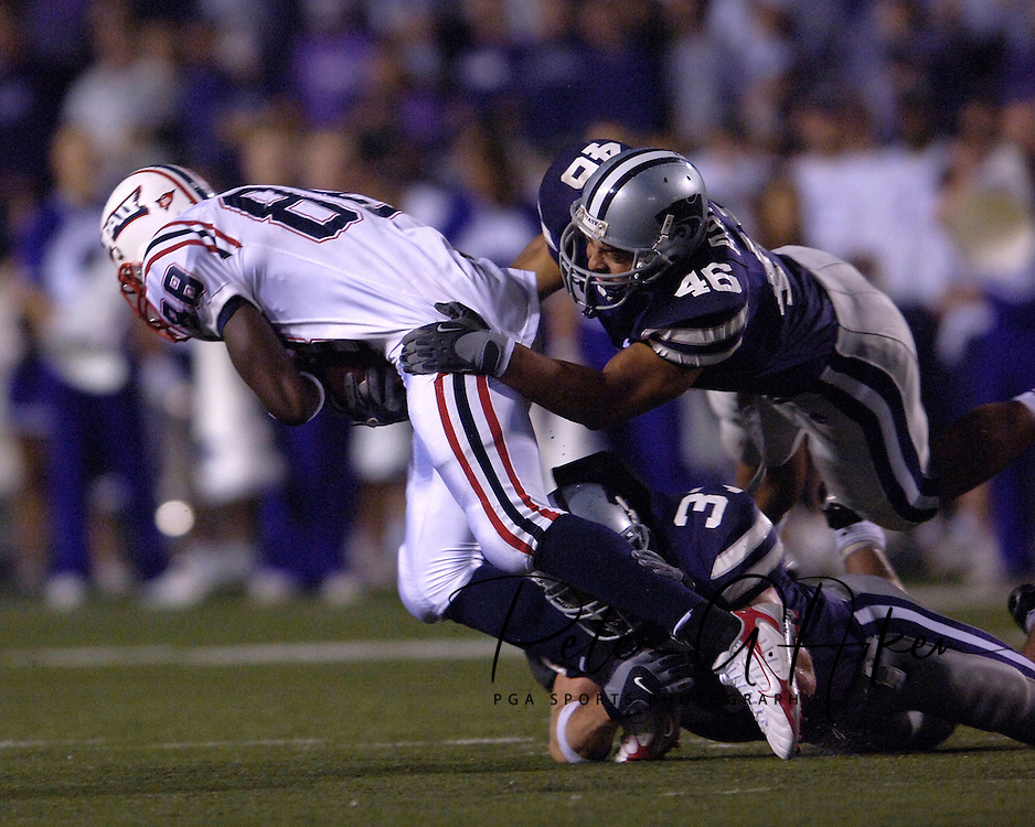 Kansas State linebackers' Brandon Archer (46) and Marcus Perry (37) bring down Florida Atlantic tight end Jason Harmon (88) after making a catch in the second half, at Bill Snyder Family Stadium in Manhattan, Kansas, September 9, 2006.  The Wildcats beat the Owls 45-0.
