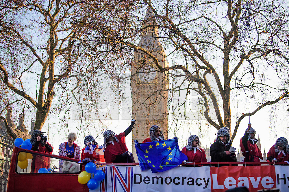 © Licensed to London News Pictures. 05/12/2016. London, UK. Pro EU supporters dressed as judges on an open top bus outside the Supreme Court  in Westminster, London for first day of a  Supreme Court hearing to appeal against a November 3 High Court ruling that Article 50 cannot be triggered without a vote in Parliament. Photo credit: Ben Cawthra/LNP