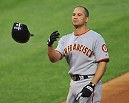 Omar Vizquel tosses his hat after flying out with the bases loaded in his first game back in Cleveland.