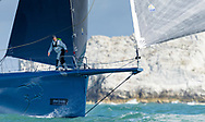Mike Slade's super maxi, Leopard 3, passes The Needles lighthouse during the Round the Island Race. Isle of Wight.<br /> Picture date: Saturday July 2, 2016.<br /> Photograph by Christopher Ison &copy;<br /> 07544044177<br /> chris@christopherison.com<br /> www.christopherison.com