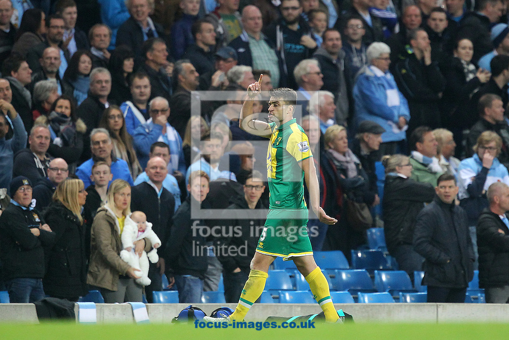 Russell Martin of Norwich (hidden) handballs a goal bound shot from Raheem Sterling of Manchester City and is sent off by Referee Robert Madley during the Barclays Premier League match at the Etihad Stadium, Manchester<br /> Picture by Paul Chesterton/Focus Images Ltd +44 7904 640267<br /> 31/10/2015
