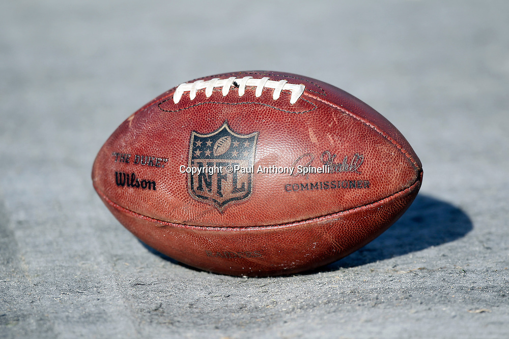 An NFL football lies in the bench area during the Oakland Raiders NFL week 16 football game against the Indianapolis Colts on Sunday, December 26, 2010 in Oakland, California. The Colts won the game 31-26. (©Paul Anthony Spinelli)