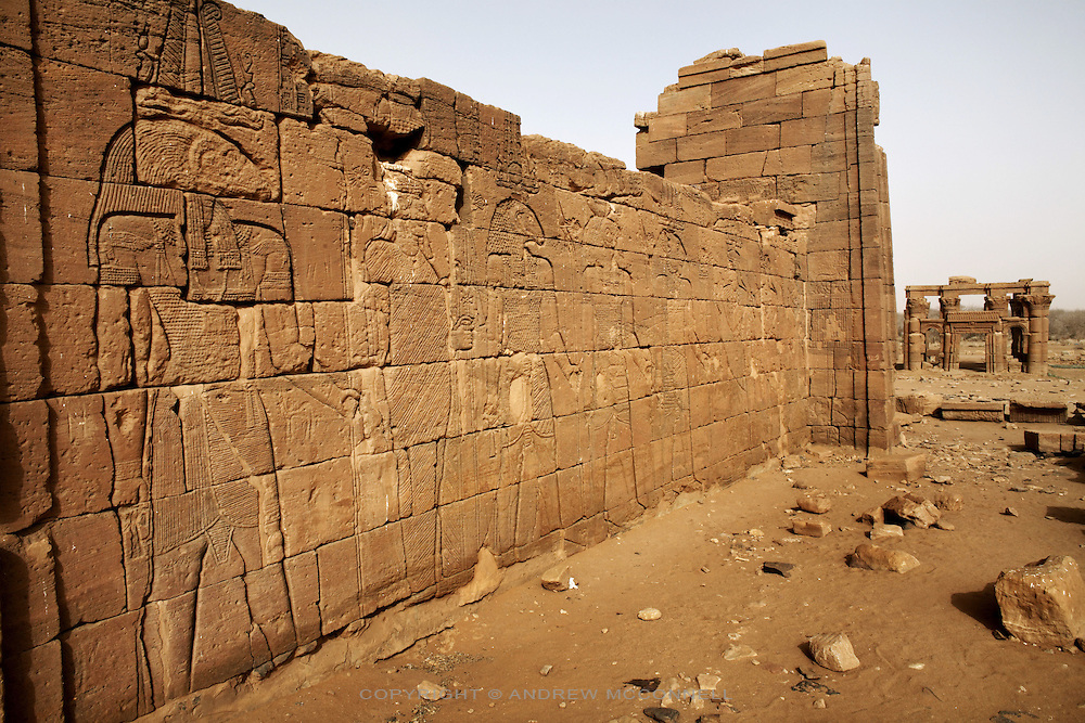 The Lion Temple, one of the Meroitic temples of Naqa, pictured on Sunday, April 1, 2007. The craved reliefs depict King Natakamani in the company of gods Amun, Horus and Apedemak. In the background is the Kiosk, a further example of Kushite architecture. ..The ancient kingdom of Kush emerged around 2000 BC in the land of Nubia, what is today northern Sudan. At their height the Nubians ruled over ancient Egypt as the 25th Dynasty between 720 BC and 664 BC (known as the Black Pharaohs) and saw their borders reach to edges of Libya and Palestine. The Kushite kings saw themselves as guardians of Egyptian religion and tradition. They centered there kindgom on the Temple of Amun at Napata (modern day Jebel Barkal) and brought back the building of Pyramids in which to inter their kings - there are around 220 pyramids in Sudan, twice the number in Egypt. After Napata was sacked, by a resurgent Egypt, the capital was moved to Meroe where a more indigenous culture developed, Egyptian hieroglyphics made way for a cursive Meroitic script, yet to be deciphered. The Meroitic kingdom eventually fell into decline in the 3rd century AD with the arrival of Christianity.