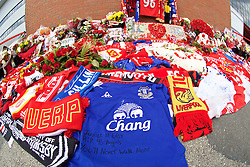 "LIVERPOOL, ENGLAND - Thursday, May 5, 2016: An Everton shirt with the message ""Justice at last RIP 96 angels You'll Never Walk Alone"" amounts the floral tributes left at Liverpool's temporary memorial to the 96 victims of the Hillsborough disaster, pictured ahead of the UEFA Europa League Semi-Final 2nd Leg match against Villarreal at Anfield. (Pic by David Rawcliffe/Propaganda)"