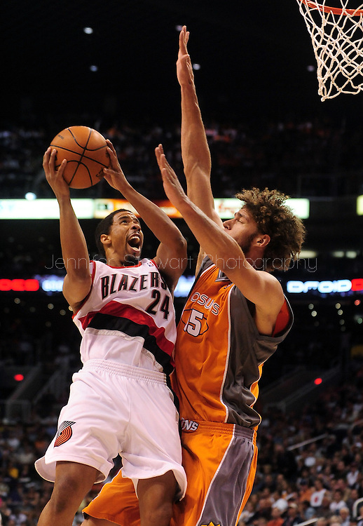 Mar. 21 2010; Phoenix, AZ, USA; Portland Trailblazers guard Andre Miller (24) puts up a shot against Phoenix Suns center Robin Lopez (15) in the first half at the US Airways Center.   Mandatory Credit: Jennifer Stewart-US PRESSWIRE.