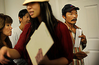 NEW ORLEANS, LA- June 22:  Dung Nguyen, right, argues his case for receiving  assistance along with other families... Vietnamese affected by the Gulf oil spill because of their work in the fishing industry, wait on an early morning line at Mary Queen of Vietnam Catholic Church to receive financial assistance from Catholic Community Services, in New Orleans, Louisiana, Tuesday June 22, 2010.  (Melina Mara/The Washington Post)