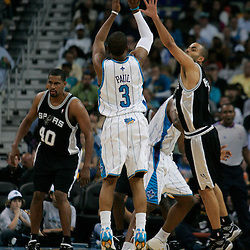 29 March 2009: New Orleans Hornets guard Chris Paul (3) shoots over San Antonio Spurs guard Tony Parker (9) during a 90-86 victory by the New Orleans Hornets over Southwestern Division rivals the San Antonio Spurs at the New Orleans Arena in New Orleans, Louisiana.