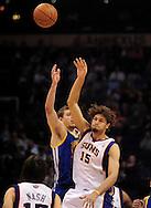 Feb. 10, 2011; Phoenix, AZ, USA; Phoenix Suns center Robin Lopez (15) wins the jump ball against the Golden State Warriors forward David Lee (10) at the US Airways Center. Mandatory Credit: Jennifer Stewart-US PRESSWIRE