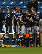 Picture by David Horn/Focus Images Ltd +44 7545 970036<br /> 03/12/2013<br /> Martyn Woolford of Millwall celebrates scoring with team mates during the Sky Bet Championship match at The Den, London.