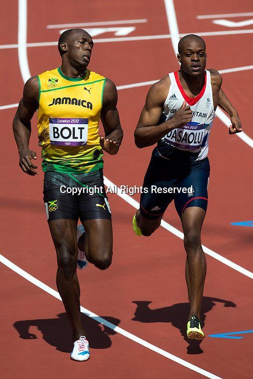 04.08.2012 Stratford, England. Jamaicas Usain Bolt (JAM) wins his heat ahead of Great Britains James Dasaolu (GBR) in third in Round 1 of the Mens 100m during the Athletics on Day 8 of the London 2012 Olympic Games at the Olympic Stadium.