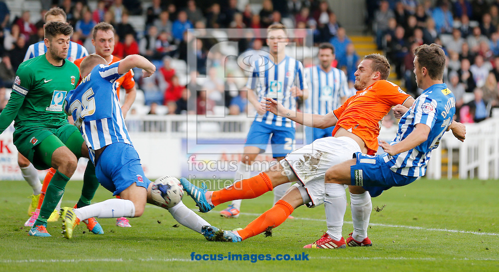 Luke Wilkinson of Luton Town shooting during the Sky Bet League 2 match at Victoria Park, Hartlepool<br /> Picture by Simon Moore/Focus Images Ltd 07807 671782<br /> 18/10/2014