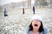 Kaimay Reynolds, 6, bottom right, catches snowflakes on her tongue while Phil Wasta, left, Maria Smotherman, center, and Stephen Goodall, right, battle at Elmwood Park on November 15, 2014 in Omaha, Neb. The group meets every Saturday throughout the year, rain or shine.