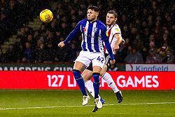 Matt Penney of Sheffield Wednesday beats Jack O'Connell of Sheffield United to the ball - Mandatory by-line: Robbie Stephenson/JMP - 09/11/2018 - FOOTBALL - Bramall Lane - Sheffield, England - Sheffield United v Sheffield Wednesday - Sky Bet Championship
