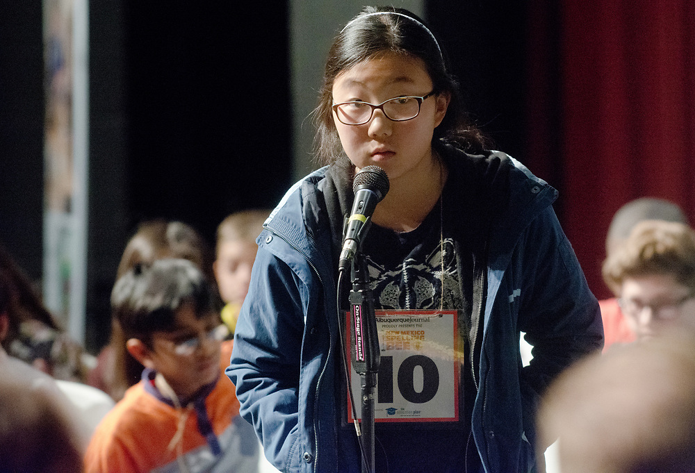Olivia Koo, a 7th grader from Los Alamos County,  spells during the 2017 New Mexico Spelling Bee at Sandia Prep, Saturday, March 18, 2017. (Marla Brose/Albuquerque Journal)