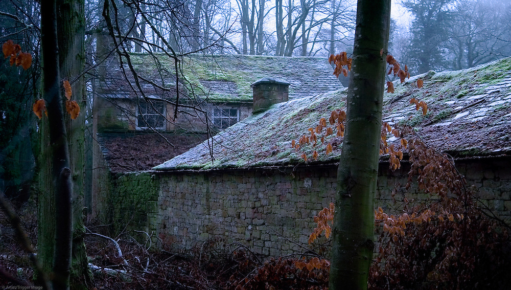 Derelict buildings of an abandonded Georgian sawmill on a cold, frosty morning. Lake District, Cumbria, UK