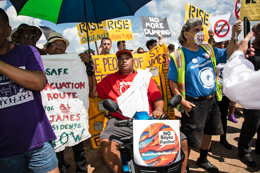 """March on Burton Lane in St. James, Louisiana during a """"Rise for Cancer Alley"""" event, one of hundreds of 'Rise for Climate"""" events world wide on Sept 8, 2018."""