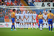 Mansfield Town forward Lee Angol (9) lines up a free kick during the EFL Sky Bet League 2 match between Mansfield Town and Luton Town at the One Call Stadium, Mansfield, England on 26 August 2017. Photo by Nigel Cole.
